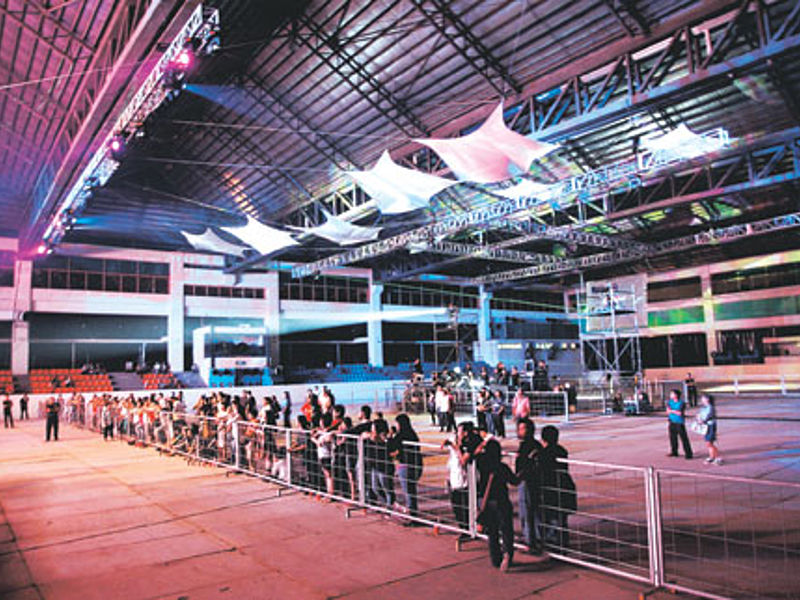 indoor exhibition event space with people's crowd