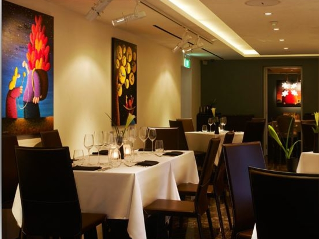 quirky paintings on the wall of the main dining area