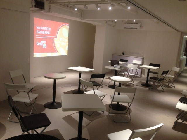 small tables for breakout sessions equipped with projector screen in event space