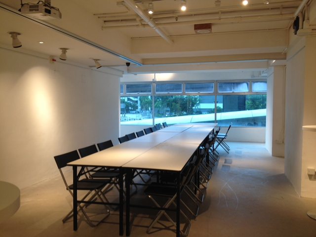 long meeting table in empty room