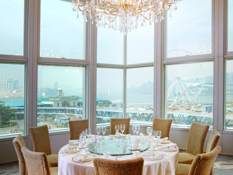 private dining area with the view of hong kong city and decorated with chandelier