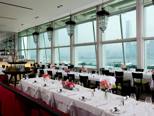 spacious dining room with panoramic view of victoria harbour hong kong