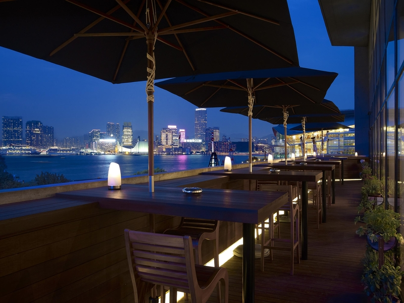 rooftop dining area overlooked the scenic views of hong kong city at night