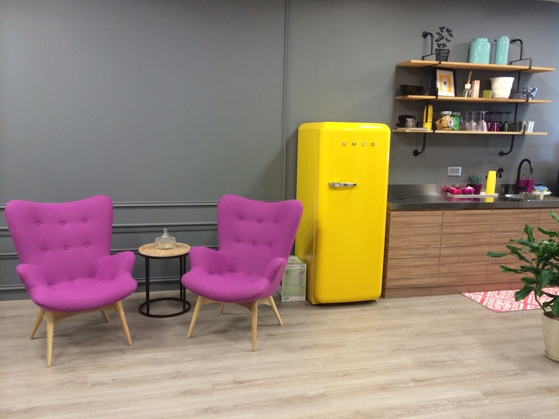 networking area beside the pantry showing the colourful furnitures
