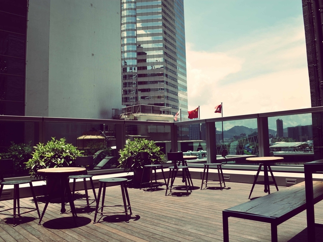 rooftop party area surrounded with the view of hong kong's building