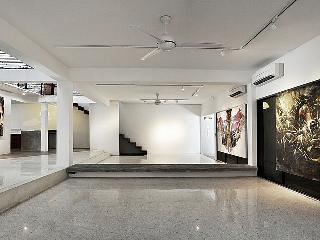 minimalist gallery with two big painting and white colour dominant