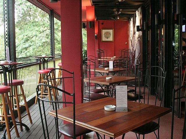 outdoor space with open windows and red wall
