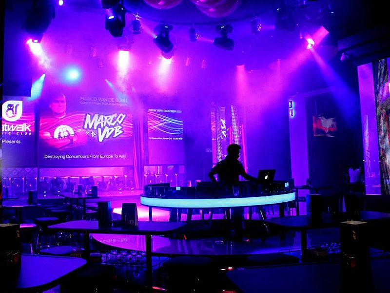 party space with dj performance and purple dominant of lighting