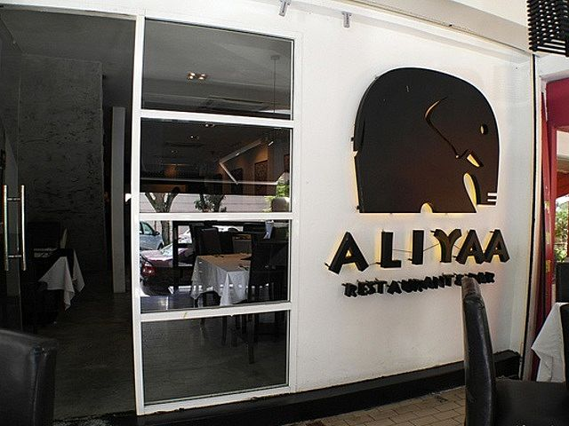 front door of aliyaa island restaurant and bar with elephant logo
