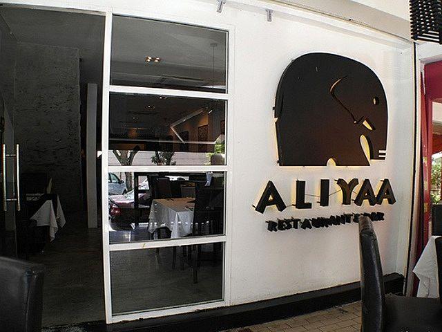 front door of aliyaa island restaurant and bar with elephant logo
