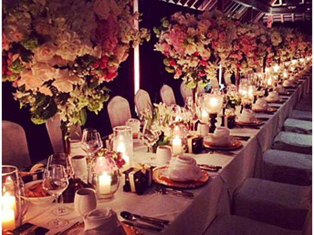 intimate outdoor wedding party with flower table decoration