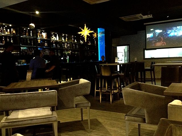 bar with screen projector and couch