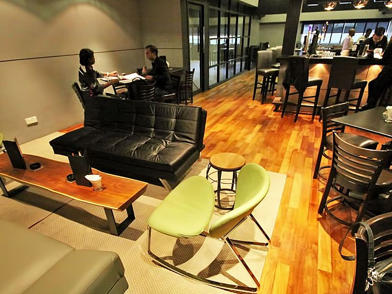 wooden floors bar dominated by black furnitures