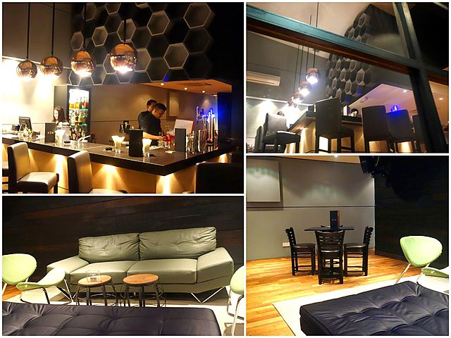 kuala lumpur bar lounge with black and pastel furnitures