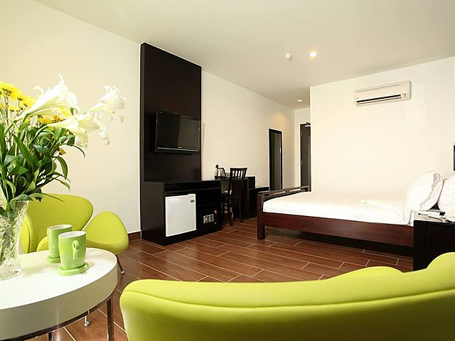 minimalist hotel room with green couch