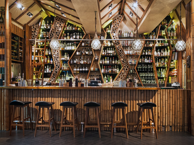 indoor bar area dominated with bamboo interior
