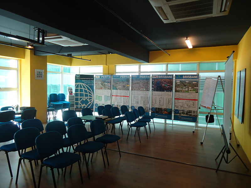 affordable meeting room in selangor with yellow wall and blue audience chairs
