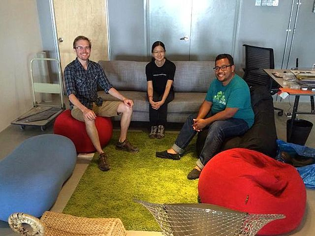 team sit together in the bean bag and couch after discussion