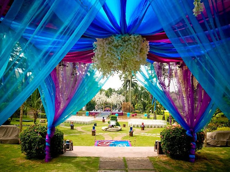 malaysian wedding decoration with blue and pink fabric