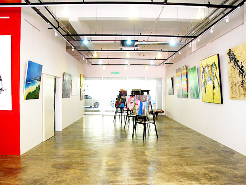 art studio with painting displayed and track lightings