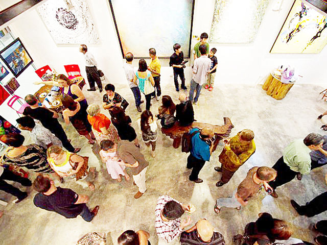 people attending art exhibition event in kuala lumpur gallery