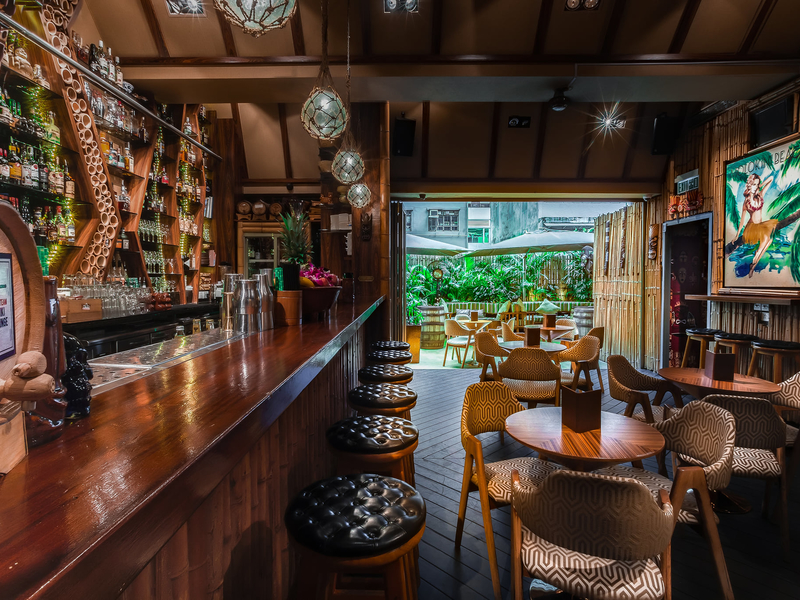 cosy polynesian elements of colourful timber and bamboo inside the bar