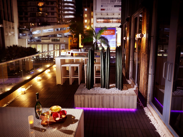 quemo rooftop party venue with wine and bar snacks