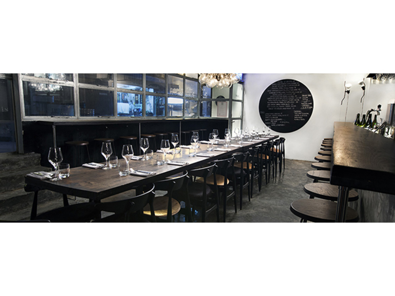 italian restaurant with sit down table setup and bar seating