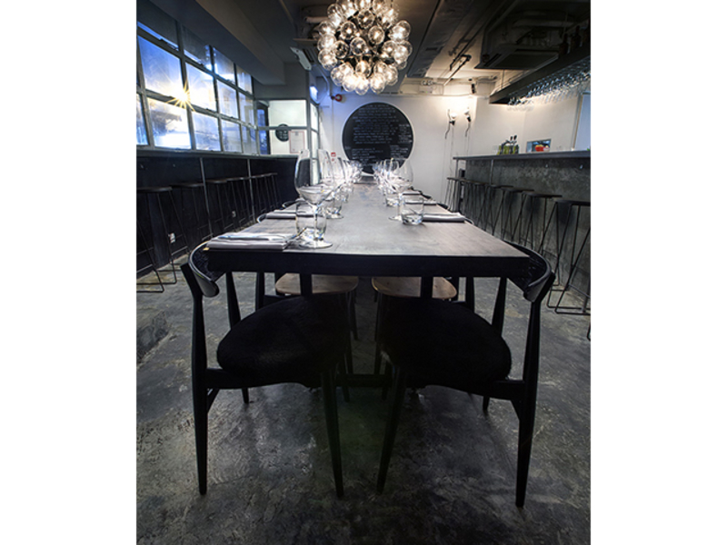 dining space decorated with circles chandelier