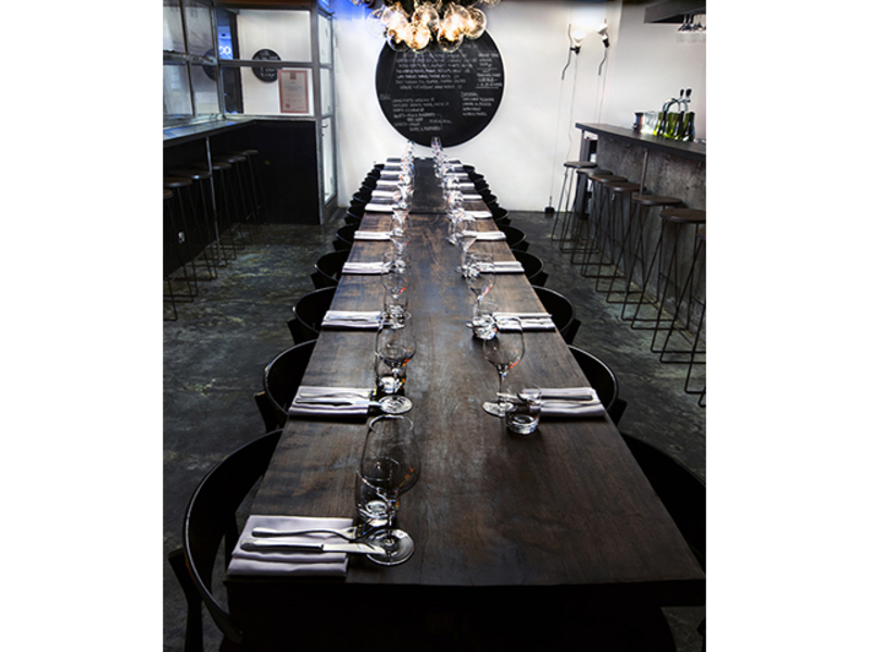 intimate space seats up to 50 pax at the wooden long table setup