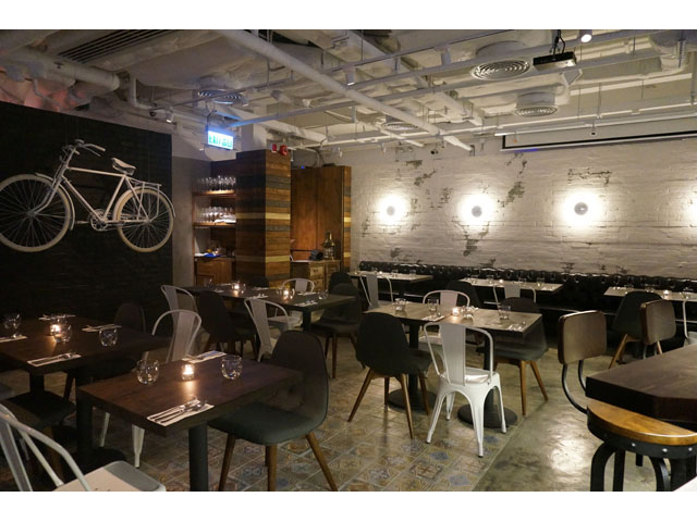 main dining space with a real bike hanging on the wall