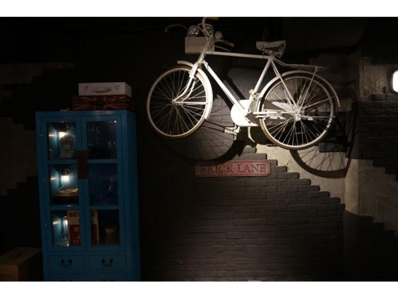 bike hanging on the wall near the cupboard