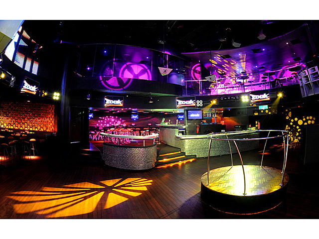 dance party room with gobos lighting and round mini stage