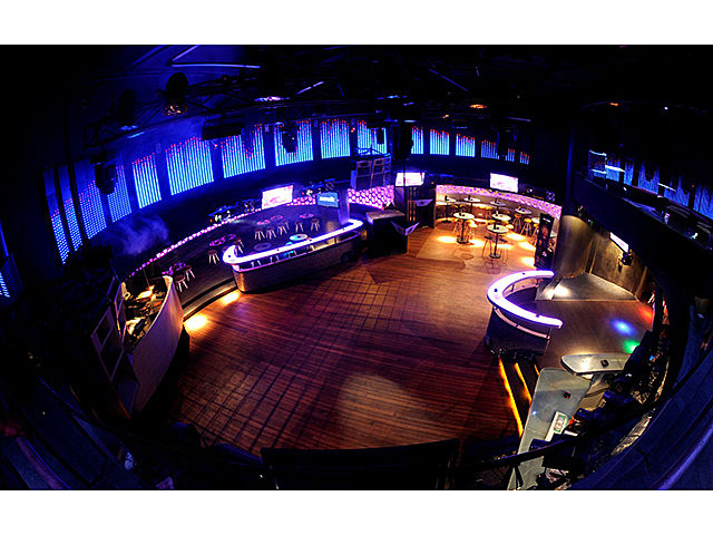 medium size night club with long led screen and wooden floors