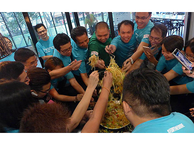 the team celebrate Chinese new year with lo hei