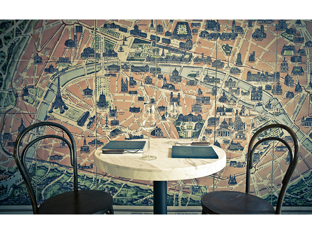 round table with bird-eye view of cityscape in background
