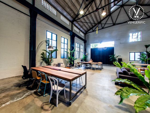 long table and large doors in singapore workshop venue
