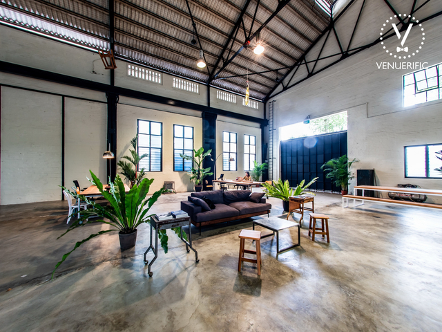 event space in singapore with industrial theme and plants surround