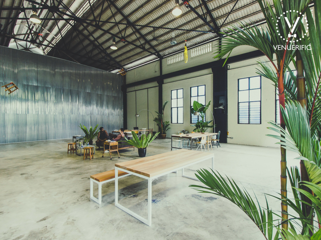 black roof truss and large windows in singapore media gathering venue