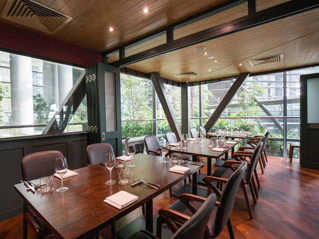 glass wall restaurant in singapore with foldable doors and wooden interior